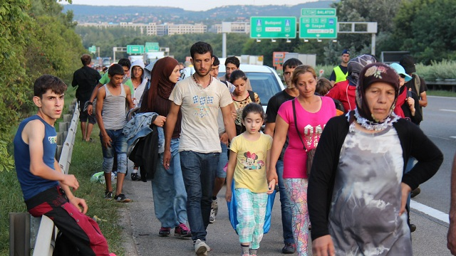 Photo taken Sept. 4, 2015 in Budapest shows a weary group of refugees walking on a highway in the Hungarian capital, heading to Austria. Refugees arrived in Europe following exhausting journeys from Syria and other troubled countries. (Kyodo) ==Kyodo